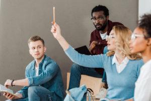 White student raising hand